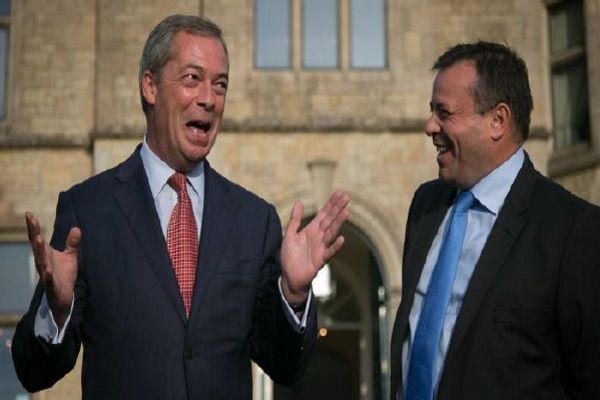 Former Ukip leader Nigel Farage celebrates Arron Bank's £1m donation to the  party in October 2014 © Getty